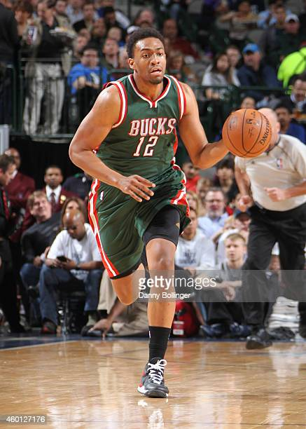 Jabari Parker of the Milwaukee Bucks handles the ball against the Dallas Mavericks on December 7 2014 at the American Airlines Center in Dallas Texas...