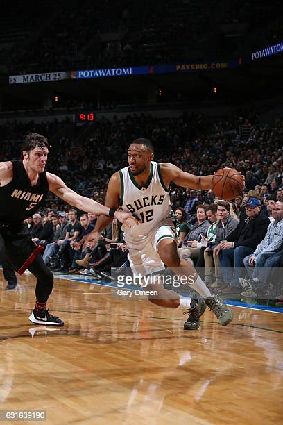 Jabari Parker of the Milwaukee Bucks handles the ball during a game against the Miami Heat on January 13 2017 at the BMO Harris Bradley Center in...