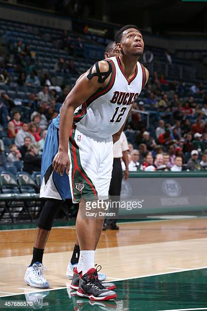 Jabari Parker of the Milwaukee Bucks looks to the basket during the game against the Minnesota Timberwolves on October 22 2014 at the BMO Harris...