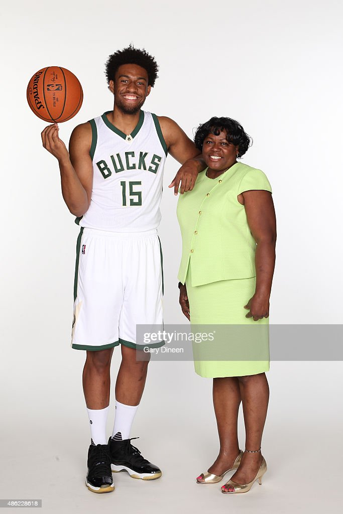 Jabari Parker #12 of the Milwaukee Bucks poses for portraits with his former grade school teacher Clintonia McNeal as part of the TeachersCount program on September 1, 2015 at Black Magnet Elementary School in Chicago, Illinois.