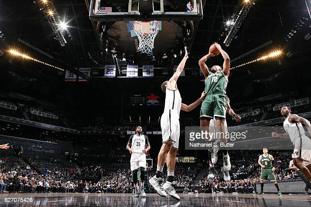 Jabari Parker of the Milwaukee Bucks shoots the ball against the Brooklyn Nets on December 1 2016 at Barclays Center in Brooklyn New York NOTE TO...