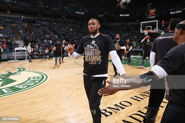 Jabari Parker of the Milwaukee Bucks wearing a warm up shirt honoring Martin Luther King Jr Day gets introduced before the game against the...