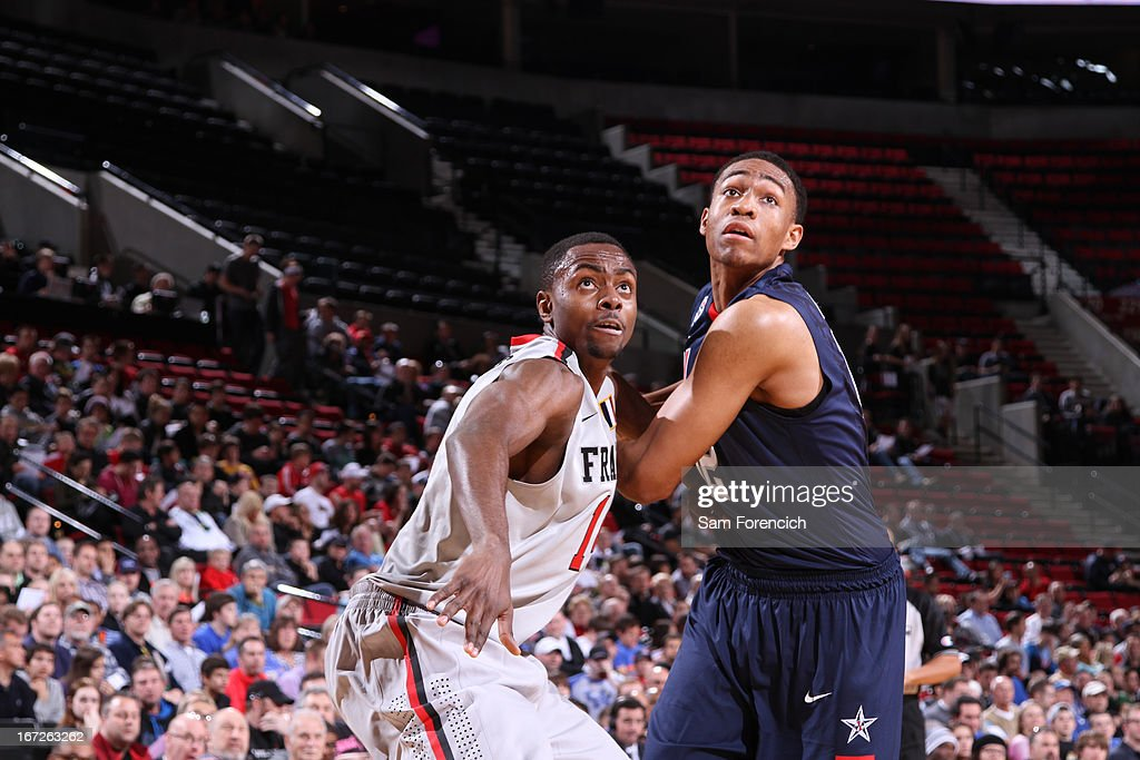 <a gi-track='captionPersonalityLinkClicked' href=/galleries/search?phrase=Jabari+Parker&family=editorial&specificpeople=9330340 ng-click='$event.stopPropagation()'>Jabari Parker</a> #12 of the USA Junior Select Team battles for positioning against Livio Jean-Charles #14 of the World Select Team during the 2013 Nike Hoop Summit game on April 20, 2013 at the Rose Garden Arena in Portland, Oregon.