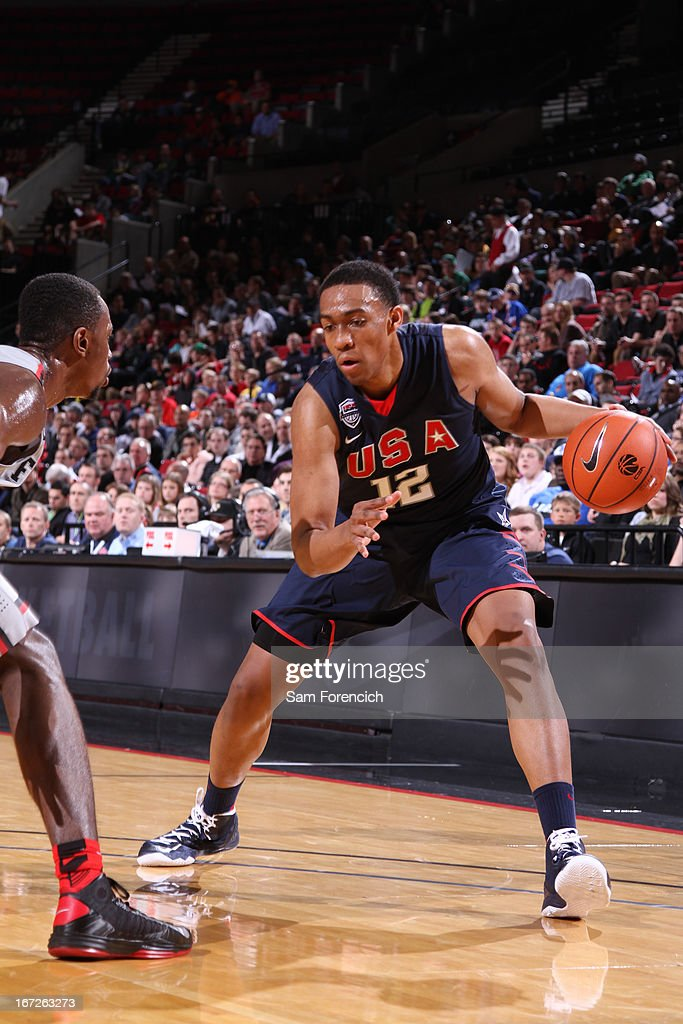 <a gi-track='captionPersonalityLinkClicked' href=/galleries/search?phrase=Jabari+Parker&family=editorial&specificpeople=9330340 ng-click='$event.stopPropagation()'>Jabari Parker</a> #12 of the USA Junior Select Team handles the ball against the World Select Team during the 2013 Nike Hoop Summit game on April 20, 2013 at the Rose Garden Arena in Portland, Oregon.
