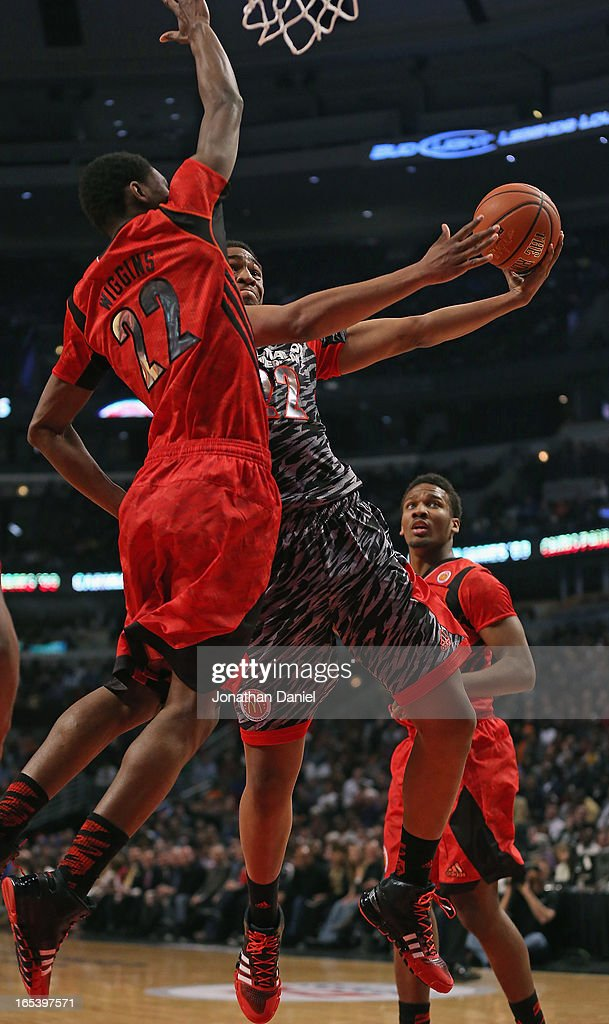 Jabari Parker #22 of the West drives against Andrew Wiggins #22 of the East during the 2013 McDonald's All American game at United Center on April 3, 2013 in Chicago, Illinois.