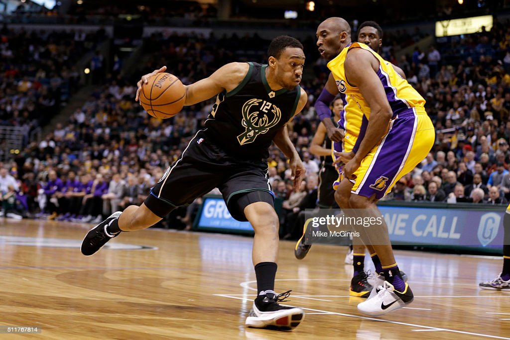 Jabari Parkers of the Milwaukee Bucks drives to the hoop against Kobe ... Jabari Parker Lakers