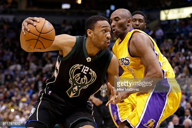 Jabari Parkers of the Milwaukee Bucks drives to the hoop against Kobe Bryant of the Los Angeles Lakers during the first quarter at BMO Harris Bradley...
