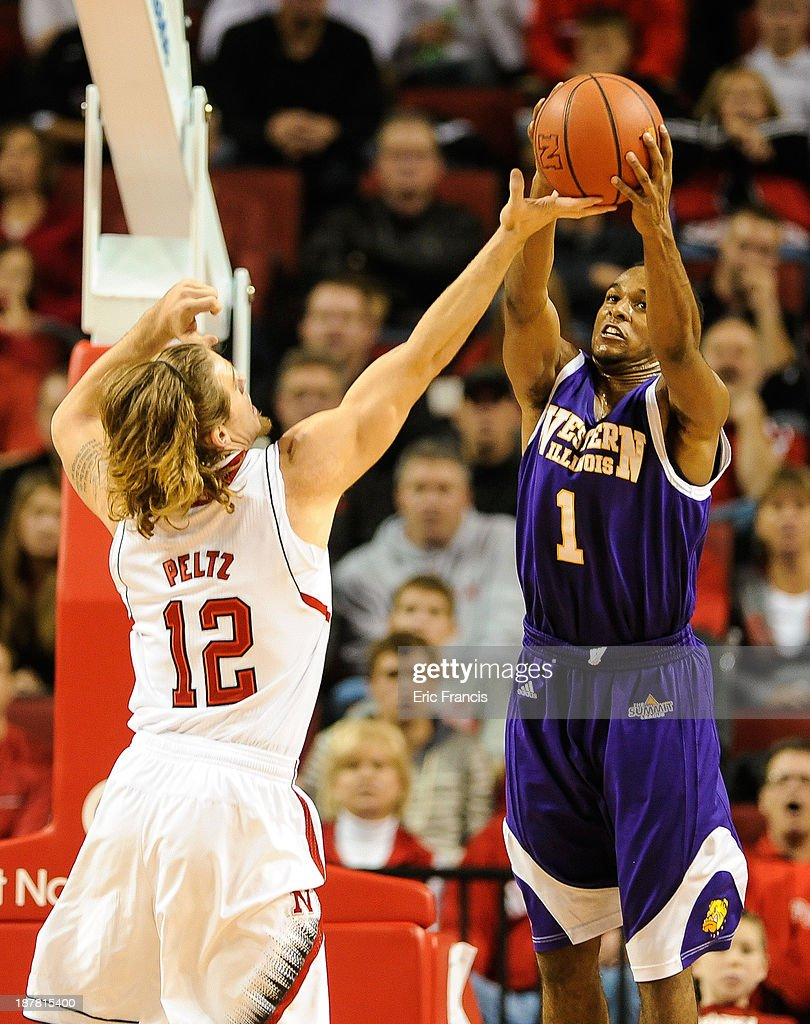 Jabari Sandifer #1 of the Western Illinois Leathernecks and Mike Peltz #12 of the Nebraska Cornhuskers reach for a rebound during their game at Pinnacle Bank Arena on November 12, 2013 in Lincoln, Nebraska.