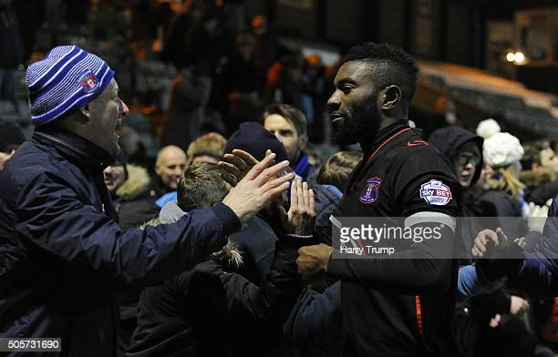 Jabo Ibehre of Carlisle United celebrates his sides victory on penalties with the fans during the Emirates FA Cup Third Round replay match between...