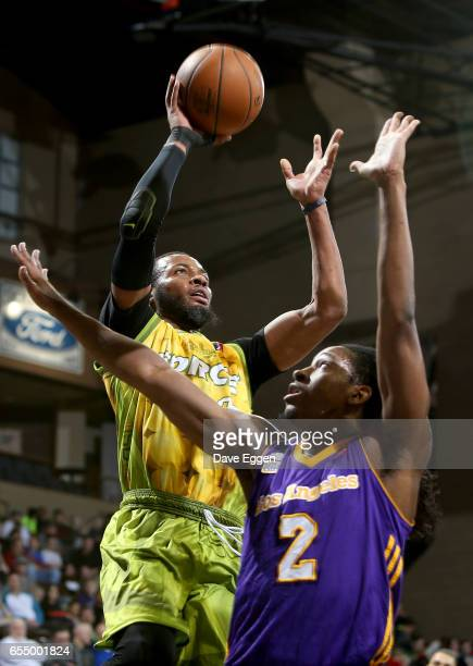 Jabril Trawick from the Sioux Falls Skyforce lays the ball up in front of Kenneth Smith from the Los Angeles DFenders at the Sanford Pentagon March...