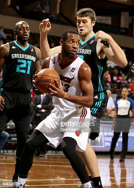 Jabril Trawick from the Sioux Falls Skyforce looks for help while being guarded by Mike Tobey from the Greensboro Swarm at the Sanford Pentagon...