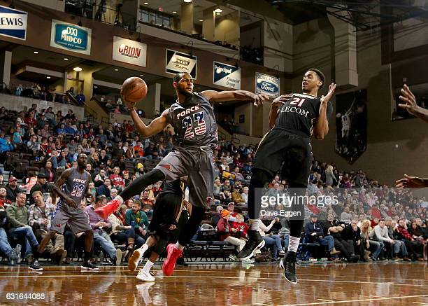 Jabril Trawick from the Sioux Falls Skyforce passes the ball around Anthony Brown from the Erie Bayhawks at the Sanford Pentagon January 13 2017 in...