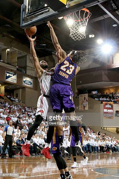 Jabril Trawick from the Sioux Falls Skyforce takes the ball to the basket against Justin Harper from the Los Angeles Defenders during the NBA DLeague...