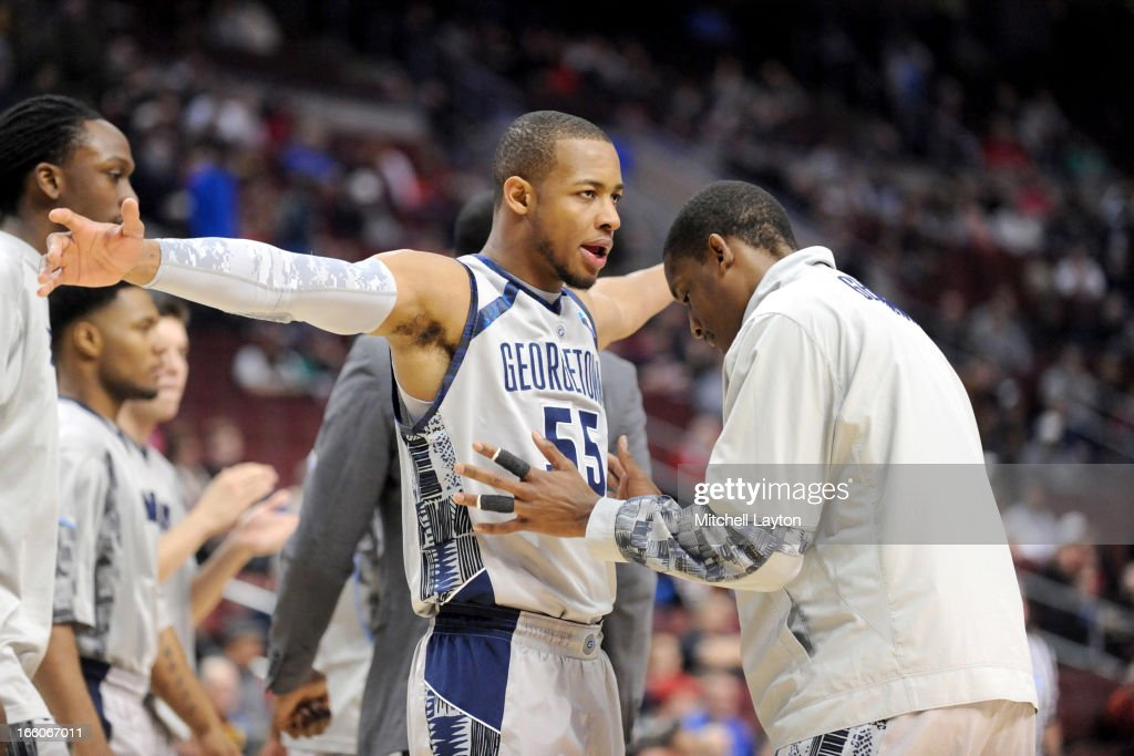 Jabril Trawick #55 of the Georgetown Hoyas and Aaron Bowen #23 during introductions of the second round of the 2013 NCAA Men's Basketball Tournament game against the Florida Gulf Coast Eagles on March 22, 2013 at Wells Fargo Center in Philadelphia, Pennsylvania. The Eagles won 78-68.