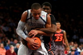 Jabril Trawick of the Georgetown Hoyas attempts to control the ball against Shaquille Thomas of the Cincinnati Bearcats during the quaterfinals of...