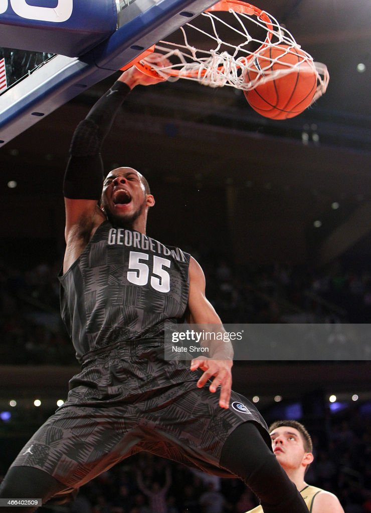 Jabril Trawick #55 of the Georgetown Hoyas cheers as he dunks the ball during the game against the Michigan State Spartans at Madison Square Garden on February 1, 2014 in New York City.