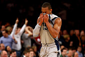 Jabril Trawick of the Georgetown Hoyas covers his face with his jersey in the second half against the Syracuse Orange during the semifinals of the...