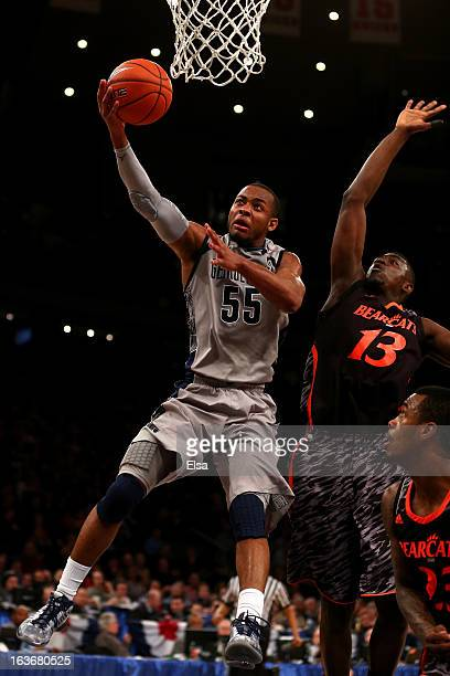 Jabril Trawick of the Georgetown Hoyas drives for a shot attempt in the second half against Cheikh Mbodj of the Cincinnati Bearcats during the...