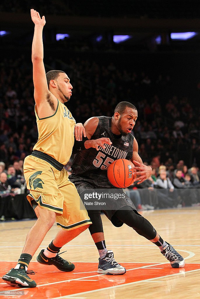 Jabril Trawick #55 of the Georgetown Hoyas drives to the basket against Denzel Valentine #45 of the Michigan State Spartans during the game at Madison Square Garden on February 1, 2014 in New York City.