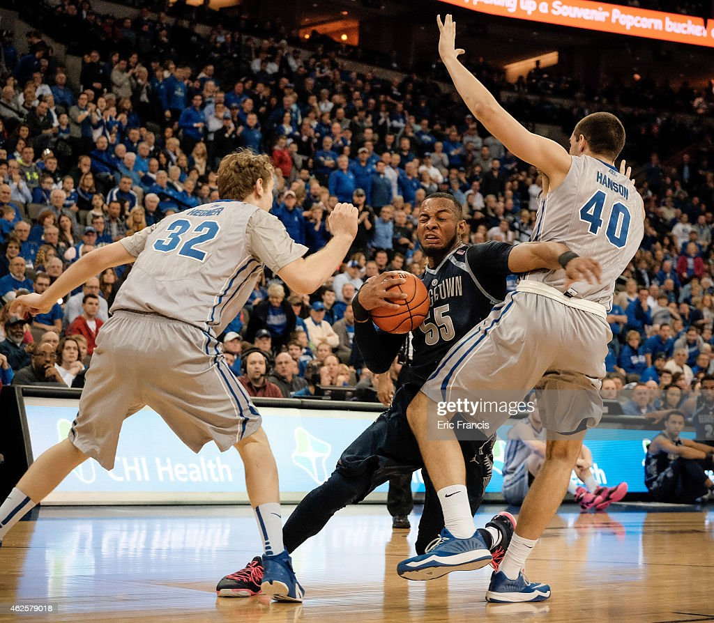 Jabril Trawick of the Georgetown Hoyas drives to the basket between Toby Hegner and Zach Hanson of the Creighton Bluejays during their game at...