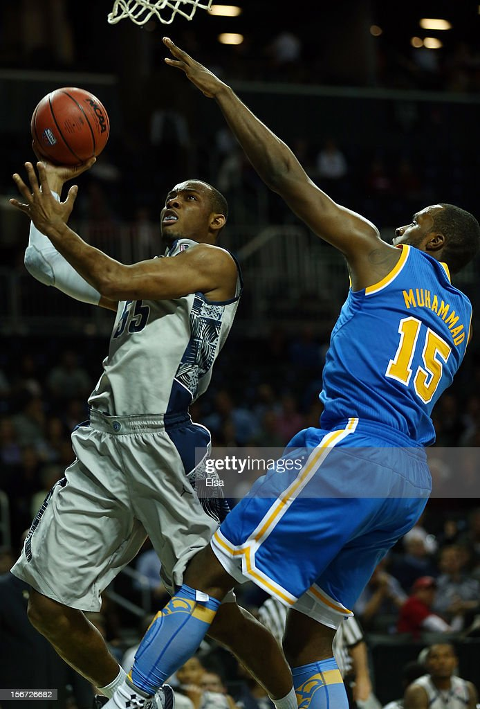 Jabril Trawick #55 of the Georgetown Hoyas heads for the net as Shabazz Muhammad #15 of the UCLA Bruins defends during the Legends Classic on November 19, 2012 at the Barclays Center in the Brooklyn borough of New York City. The Georgetown Hoyas defeated the UCLA Bruins 78-70.
