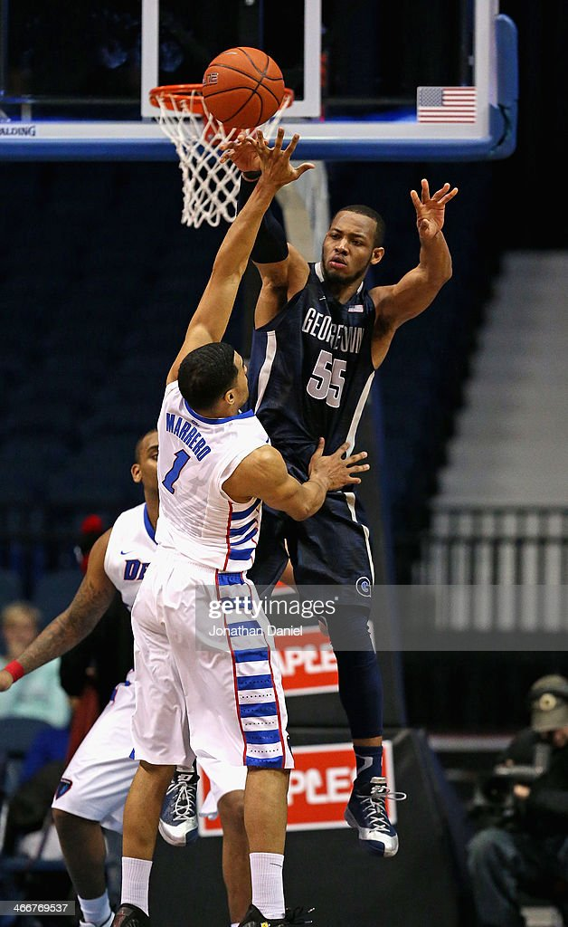Jabril Trawick #55 of the Georgetown Hoyas leaps to pass over DeJaun Marrero #1 of the DePaul Blue Demons at the Allstate Arena on February 3, 2014 in Rosemont, Illinois. Georgetown defeated DePaul 71-59.