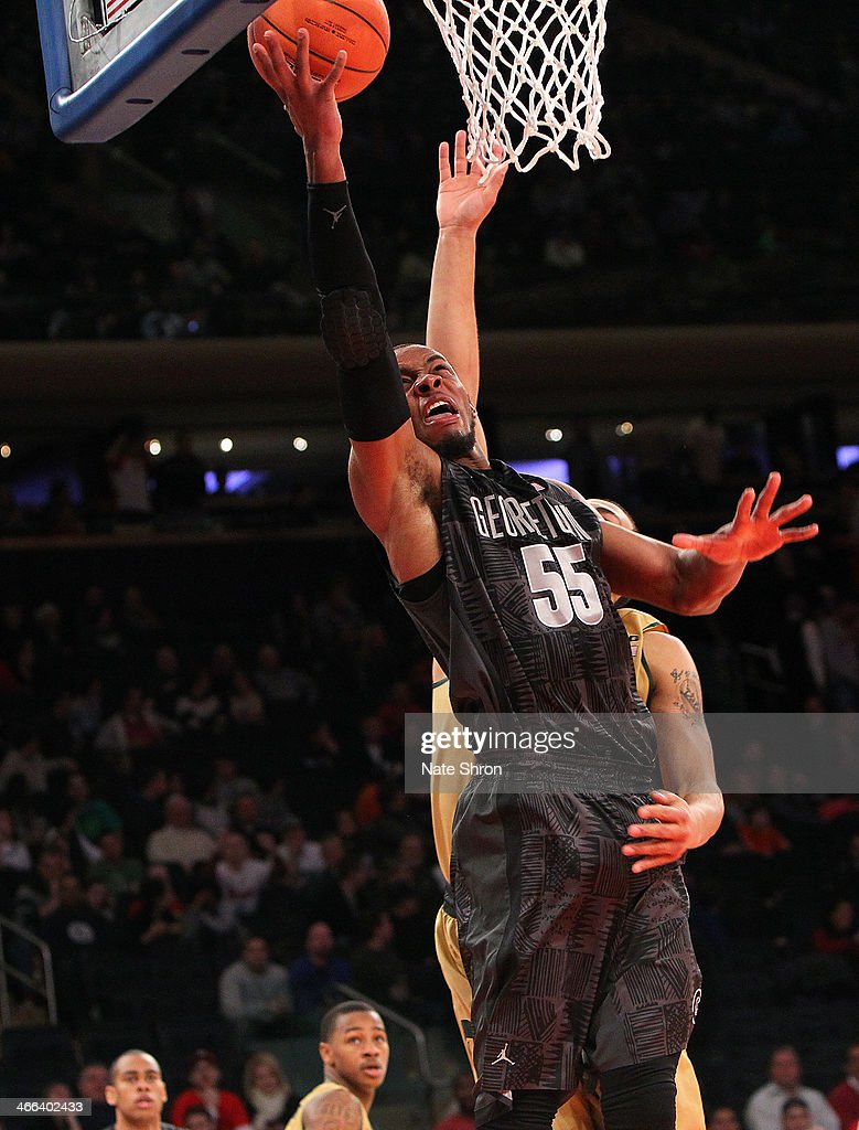 Jabril Trawick #55 of the Georgetown Hoyas puts the ball up to the basket against Denzel Vaneltine #45 of the Michigan State Spartans during the game at Madison Square Garden on February 1, 2014 in New York City.