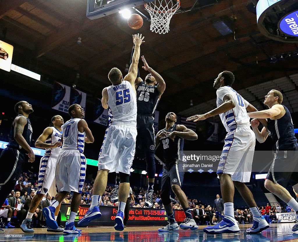 Jabril Trawick #55 of the Georgetown Hoyas puts up a shot over Sandi Marcius #55 of the DePaul Blue Demons at the Allstate Arena on February 3, 2014 in Rosemont, Illinois.