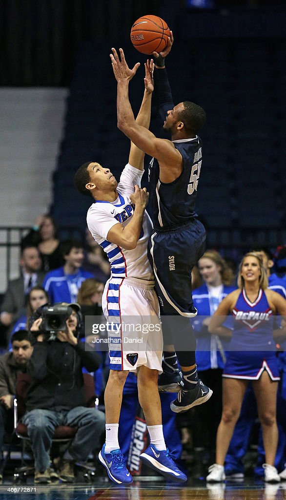 Jabril Trawick #55 of the Georgetown Hoyas shoots over Billy Garrett Jr. #5 of the DePaul Blue Demons at the Allstate Arena on February 3, 2014 in Rosemont, Illinois. Georgetown defeated DePaul 71-59.