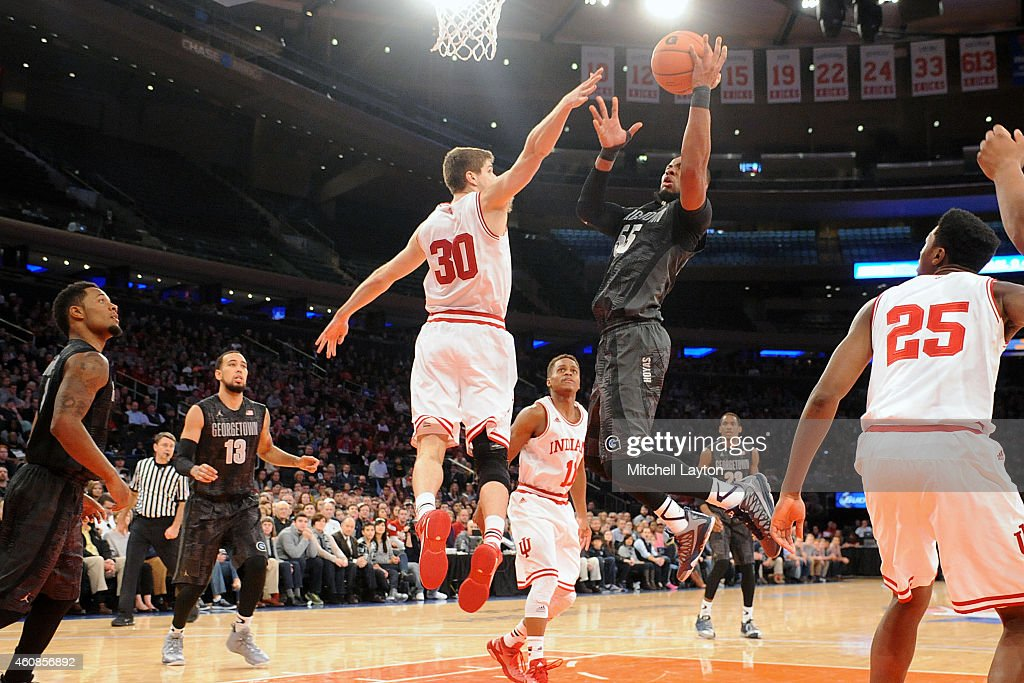 Jabril Trawick of the Georgetown Hoyas takes a shot over Collin Hartman of the Indiana Hoosiers during a college basketball game at Madison Square...
