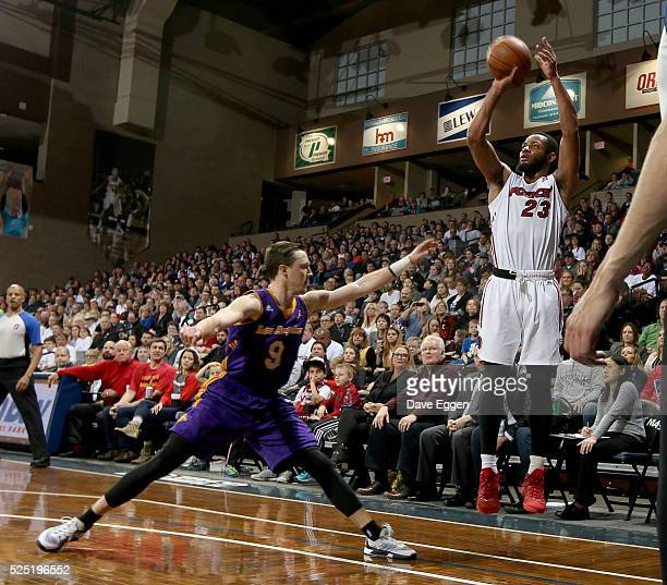 Jabril Trawick of the Sioux Falls Skyforce spots up for a jumper over Josh Magette of the Los Angeles Defenders during the NBA DLeague Finals Game 3...