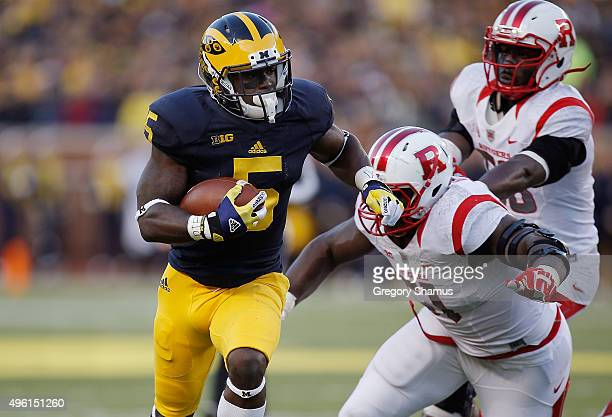 Jabrill Peppers of the Michigan Wolverines gets past the tackle of Sebastian Joseph of the Rutgers Scarlet Knights and runs for a second quarter...