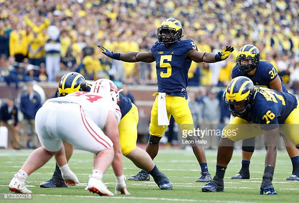 Jabrill Peppers of the Michigan Wolverines lines up at quarterback during the third quarter of the game against the Wisconsin Badgers at Michigan...