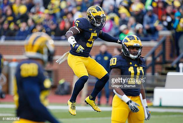 Jabrill Peppers of the Michigan Wolverines loosens up during the Michigan Football Spring Game on April 1 2016 at Michigan Stadium in Ann Arbor...
