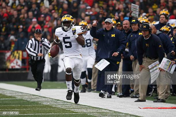 Jabrill Peppers of the Michigan Wolverines returns a first half punt against the Maryland Terrapins at Byrd Stadium on October 3 2015 in College Park...