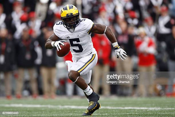 Jabrill Peppers of the Michigan Wolverines runs after intercepting a pass from JT Barrett of the Ohio State Buckeyes during the second half of their...
