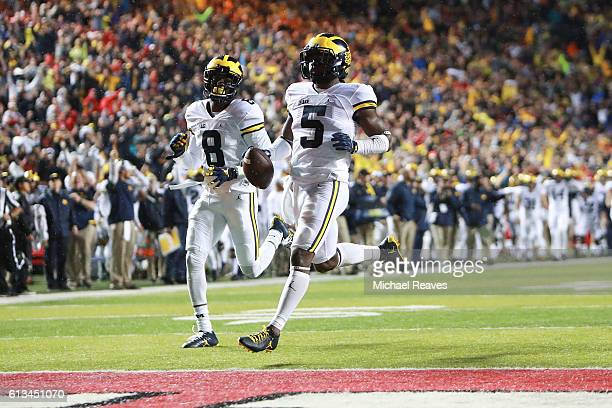 Jabrill Peppers of the Michigan Wolverines runs into the endzone after a punt return which was later called back due to a penalty against the Rutgers...