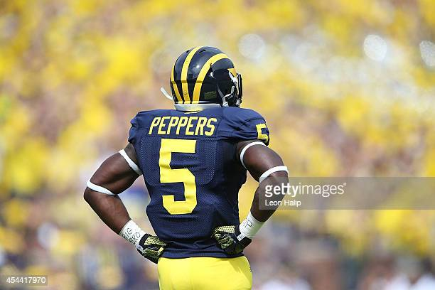 Jabrill Peppers of the Michigan Wolverines warms up prior to the start of the game against the Appalachian State Mountaineers on August 30 2014 in...