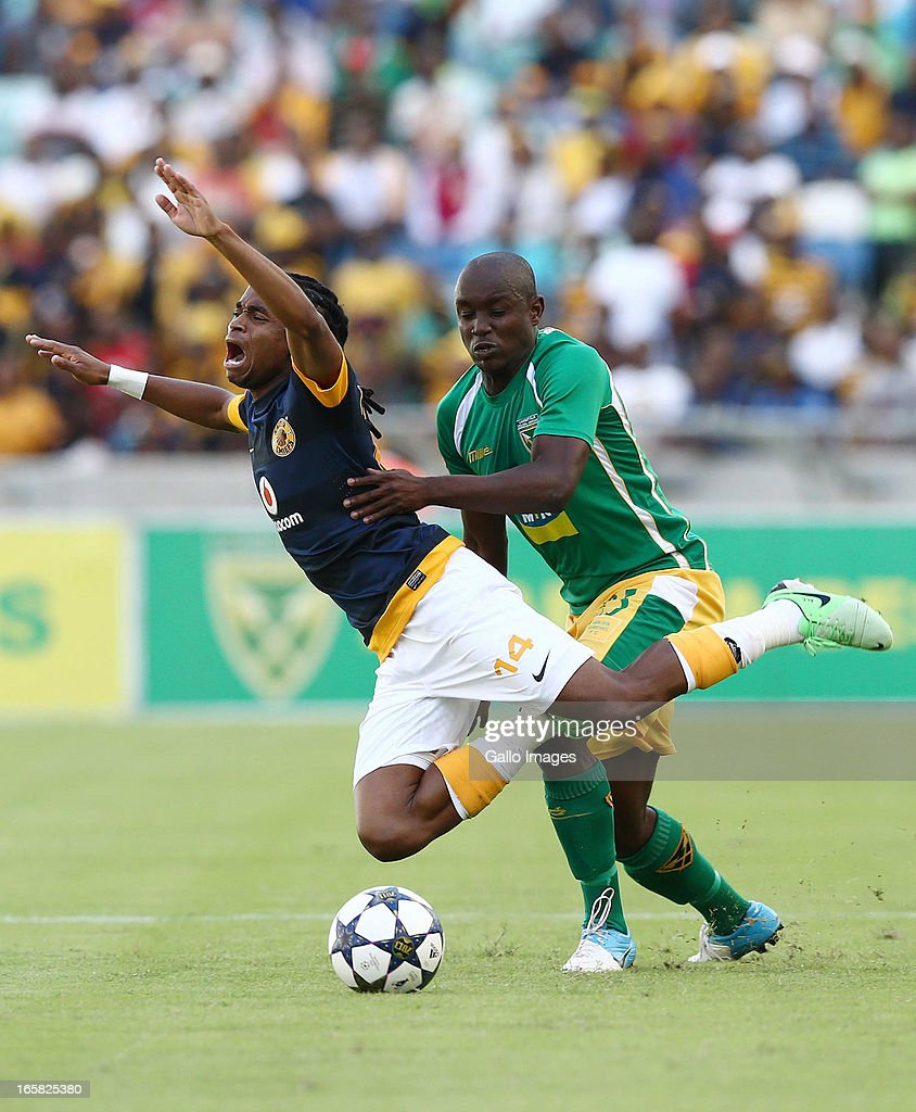 Jabulani Nene brings down Siphiwe Tshabalala during the Absa Premiership match between Golden Arrows and Kaizer Chiefs at Moses Mabhida Stadium on April 06, 2013 in Durban, South Africa.