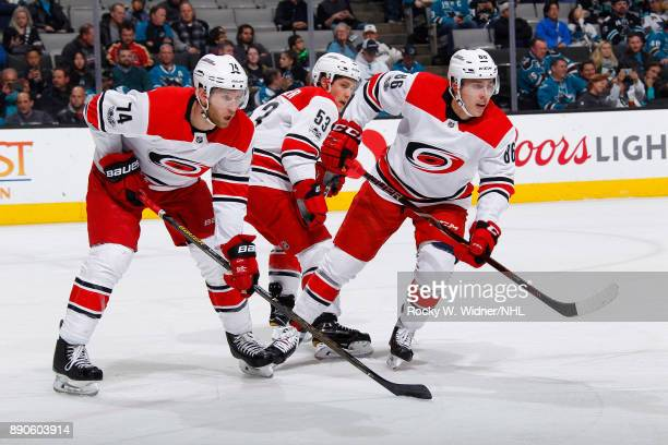 Jaccob Slavin Jeff Skinner and Teuvo Teravainen of the Carolina Hurricanes face off against the San Jose Sharks at SAP Center on December 7 2017 in...