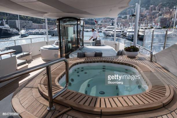 A jaccuzzi pool sits on deck of Latitude manufactured by Azimut Benetti SpA during the Monaco Yacht Show in Port Hercules Monaco on Wednesday Sept 27...