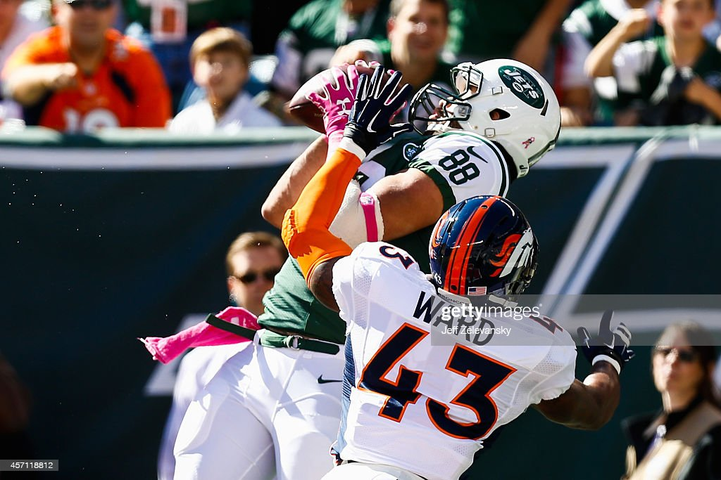 <a gi-track='captionPersonalityLinkClicked' href=/galleries/search?phrase=Jace+Amaro&family=editorial&specificpeople=10097057 ng-click='$event.stopPropagation()'>Jace Amaro</a> #88 of the New York Jets makes a catch in the endzone over <a gi-track='captionPersonalityLinkClicked' href=/galleries/search?phrase=T.J.+Ward&family=editorial&specificpeople=4640262 ng-click='$event.stopPropagation()'>T.J. Ward</a> #43 of the Denver Broncos in the first quarter at MetLife Stadium on October 12, 2014 in East Rutherford, New Jersey.