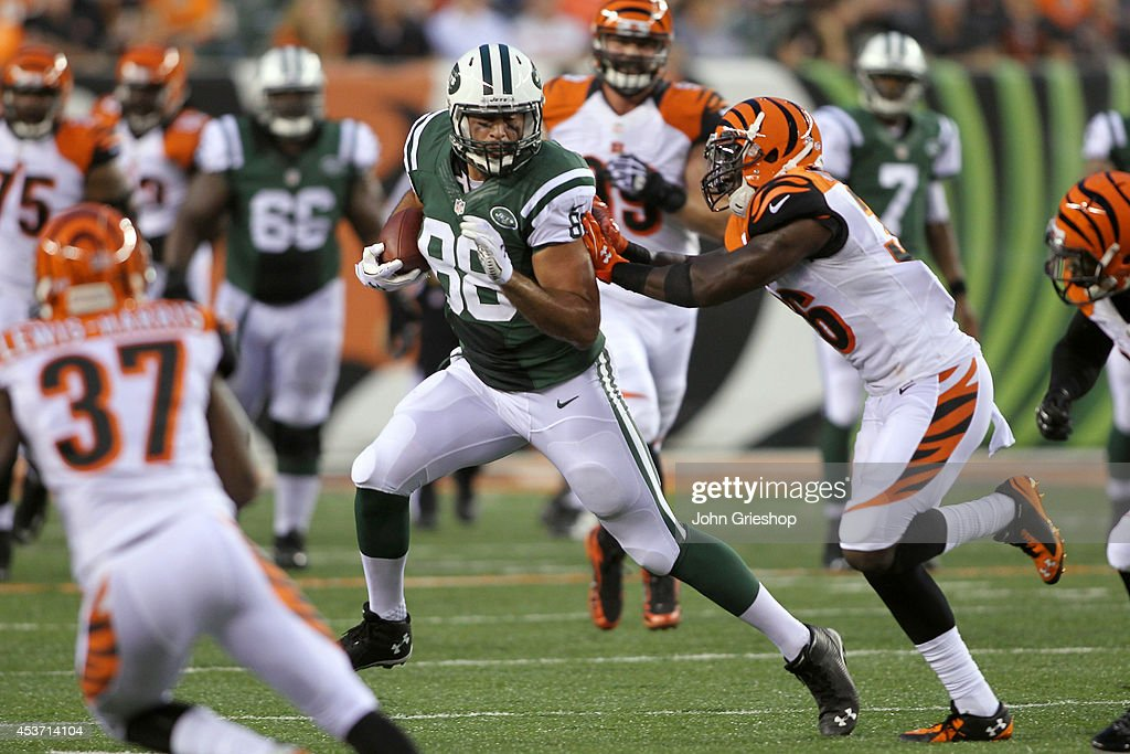 <a gi-track='captionPersonalityLinkClicked' href=/galleries/search?phrase=Jace+Amaro&family=editorial&specificpeople=10097057 ng-click='$event.stopPropagation()'>Jace Amaro</a> #88 of the New York Jets runs the football upfield against Shawn Williams #36 of the Cincinnati Bengals during their game at Paul Brown Stadium on August 16, 2014 in Cincinnati, Ohio. The Jets defeated the Bengals 25-17.