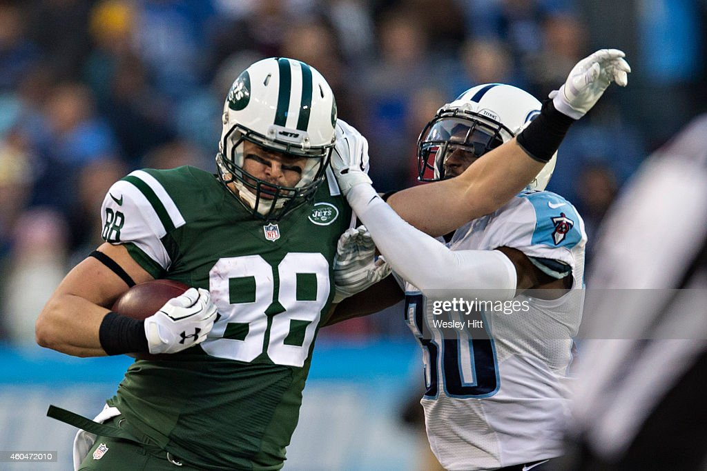 <a gi-track='captionPersonalityLinkClicked' href=/galleries/search?phrase=Jace+Amaro&family=editorial&specificpeople=10097057 ng-click='$event.stopPropagation()'>Jace Amaro</a> #88 of the Tennessee Titans is knocked out of bounds by <a gi-track='captionPersonalityLinkClicked' href=/galleries/search?phrase=Jason+McCourty&family=editorial&specificpeople=4037211 ng-click='$event.stopPropagation()'>Jason McCourty</a> #30 of the New York Jets at LP Field on December 14, 2014 in Nashville, Tennessee. The Jets defeated the Titans 16-11.