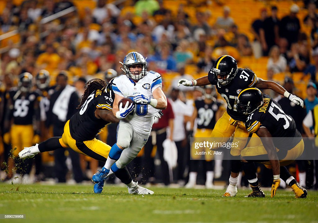 Jace Billingsley of the Detroit Lions catches a 27 yard touchdown pass in the fourth quarter against Steven Johnson Jordan Dangerfield and Ricardo...