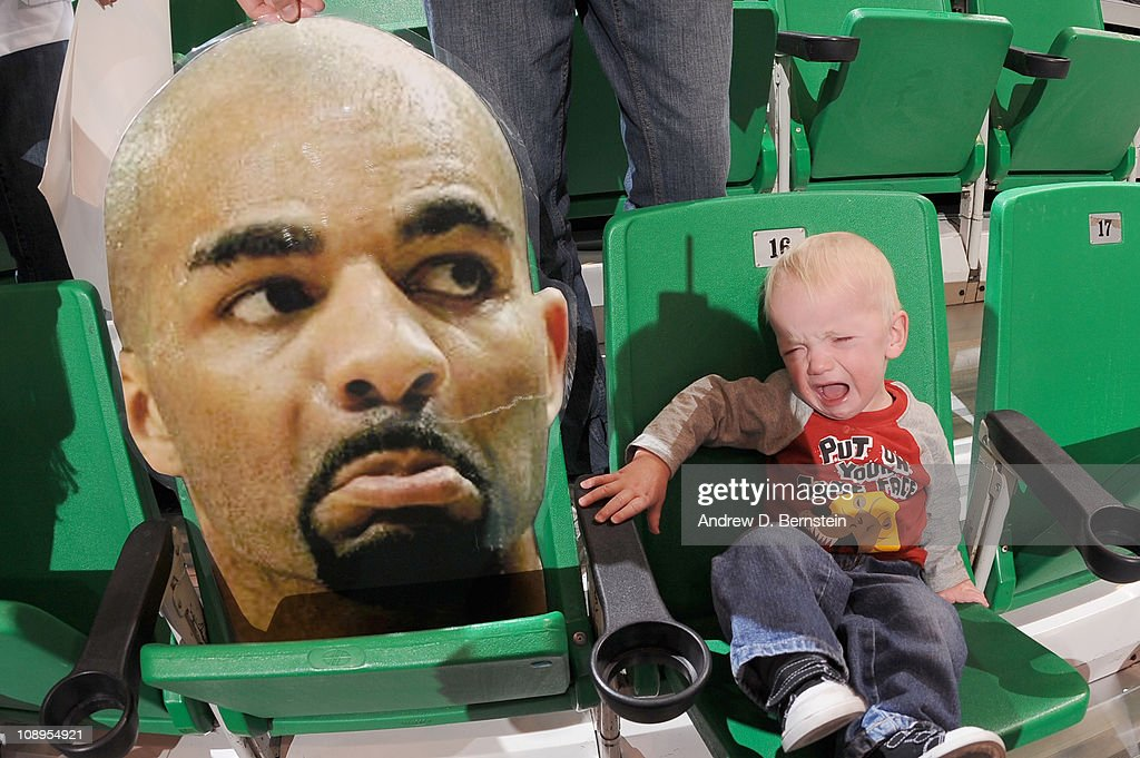 Jace Iverson a young fan of the Utah Jazz cries next to the head sign of Carlos Boozer #5 of the Chicago Bulls at EnergySolutions Arena on February 9, 2011 in Salt Lake City, Utah.