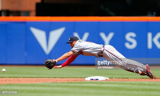 Jace Peterson of the Atlanta Braves can't come up with a ball hit in the first inning for a hit by Juan Lagares of the New York Mets at Citi Field on...