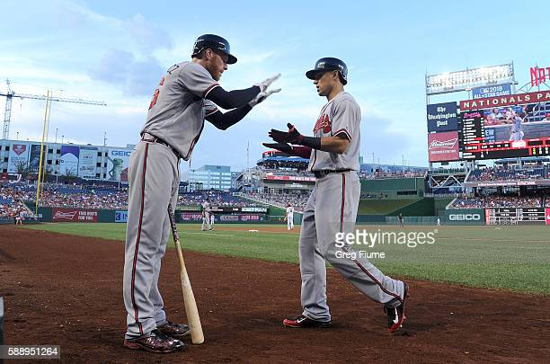 Jace Peterson of the Atlanta Braves celebrates with Mike Foltynewicz after hitting a home run in the second inning against the Washington Nationals...