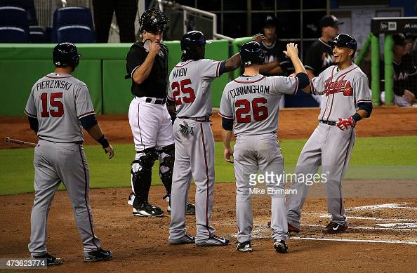 Jace Peterson of the Atlanta Braves is congratulated by Cameron Maybin AJ Pierzynski and Todd Cunningham after hitting a grand slam in the second...