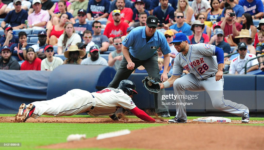 <a gi-track='captionPersonalityLinkClicked' href=/galleries/search?phrase=Jace+Peterson&family=editorial&specificpeople=7265898 ng-click='$event.stopPropagation()'>Jace Peterson</a> #8 of the Atlanta Braves just gets back to first base against <a gi-track='captionPersonalityLinkClicked' href=/galleries/search?phrase=James+Loney&family=editorial&specificpeople=636293 ng-click='$event.stopPropagation()'>James Loney</a> #28 of the New York Mets in the third inning at Turner Field on June 26, 2016 in Atlanta, Georgia.